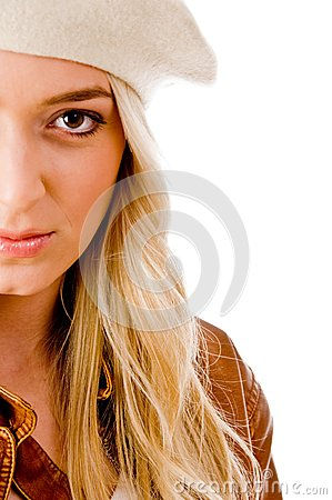 Side view of beautiful woman looking at camera