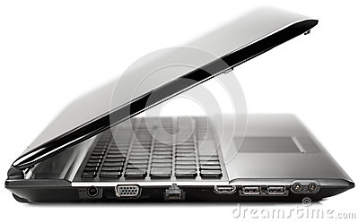 Side view of a black modern laptop on a white back