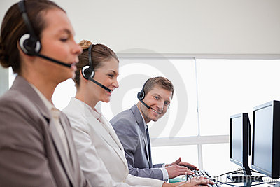 Side view of call center team