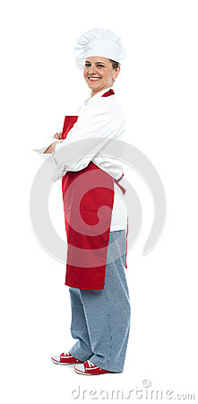 Side view of confident middle aged female chef
