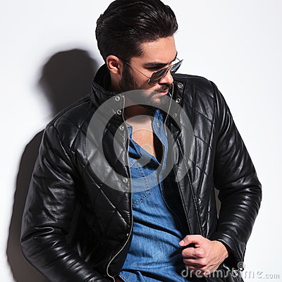 Side view of a dramatic fashion male model posing