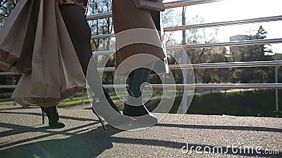 Side view of females legs walking on bridge stock footage