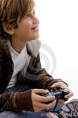Side view of glad young kid enjoying videogame