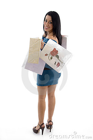 Side view of happy model carrying carry bags