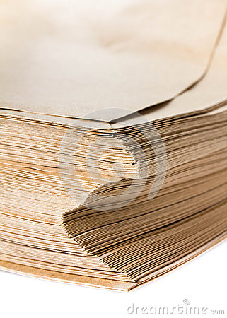 Side View Of Huge Stack of Recycled Paper cardstocks  isolated o