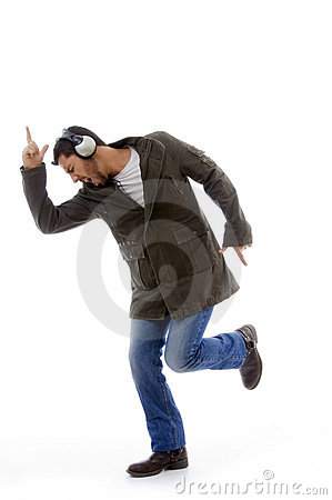 Side view of man enjoying music