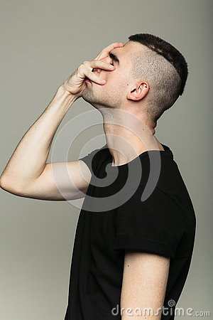 Side-view of man, who feeling shame Stock Photo