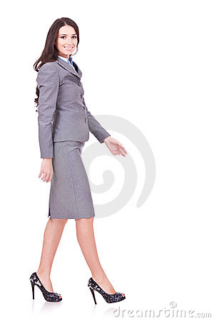 Free Side View Of A Business Woman Walking Royalty Free Stock Photography - 22088877