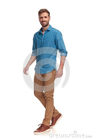 Free Side View Of A Laughing Young Casual Man Walking Stock Image - 125239741