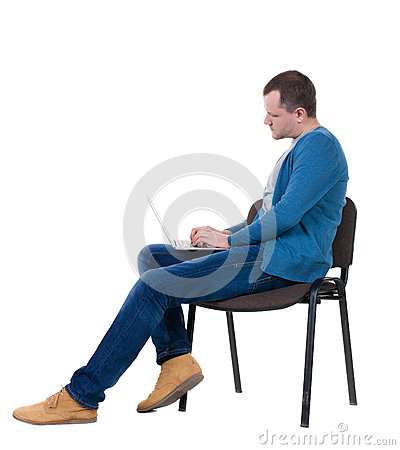 Free Side View Of A Man Sitting On A Chair To Study With A Laptop. Stock Photography - 44470722