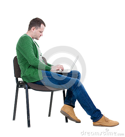 Free Side View Of A Man Sitting On A Chair To Study With A Laptop. Royalty Free Stock Images - 52184039