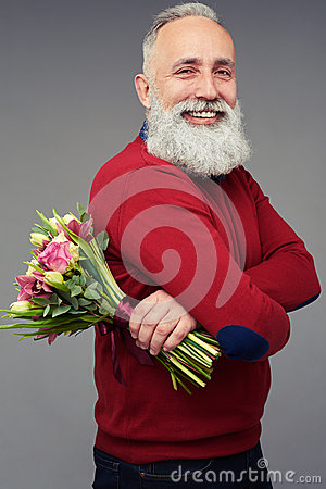 Free Side View Of A Man With A Colorful Bouquet Of Flowers Royalty Free Stock Photos - 86980788