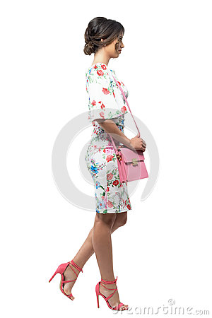 Free Side View Of Luxurious Elegant Fashion Woman With Pink Bag Walking And Looking Away. Royalty Free Stock Image - 94676066