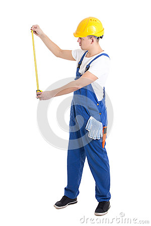 Free Side View Of Man Builder In Blue Coveralls Holding Measure Tape Stock Photography - 49533672