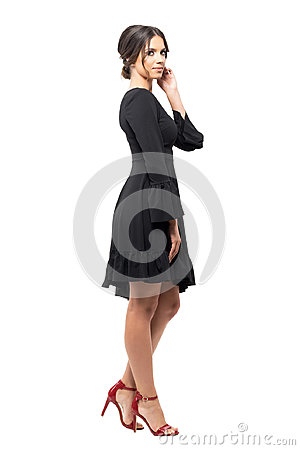Free Side View Of Passionate Hispanic Dancer Relaxing And Touching Hair Looking At Camera. Stock Image - 95439541