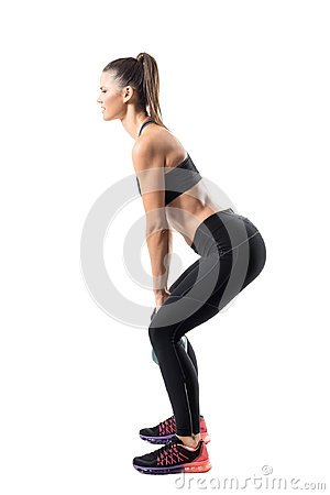 Free Side View Of Strong Fitness Gym Girl Swinging Kettlebell In Lower Position. Royalty Free Stock Image - 97914996