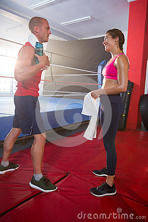 Free Side View Of Young Male And Female Athletes Talking By Boxing Ring Stock Image - 95866891
