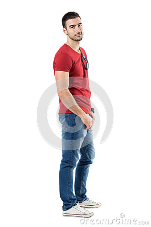 Free Side View Of Young Relaxed Casual Man In Red T-shirt And Jeans Looking At Camera Stock Photos - 90741853