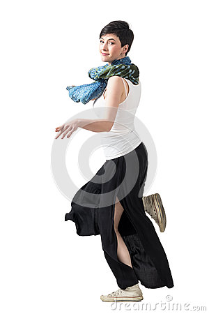 Free Side View Of Young Short Hair Woman In Wide-leg Pants Running Turning Head To Camera Royalty Free Stock Photos - 76135848