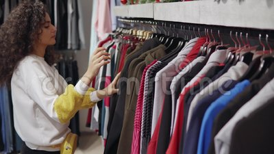 2503c0f61b5f9 Trendy Girl Shopping In Mall Alone. Stock Video - Video of mall, buyer:  145442647