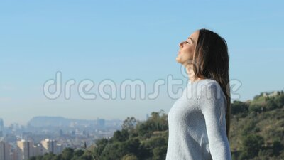 Woman breathing fresh air far from city. Side view portrait of a relaxed woman breathing fresh air far from city stock footage