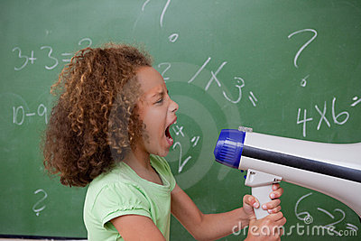 Side view of a schoolgirl screaming through a megaphone