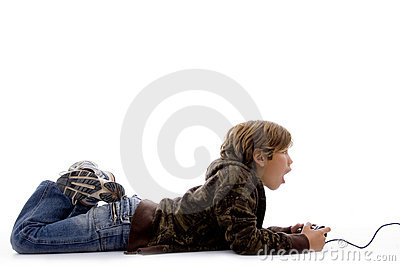 Side view of shocked boy playing videogame