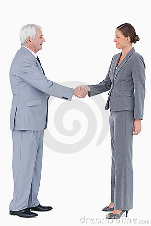 Side view of smiling businesspartner shaking hands