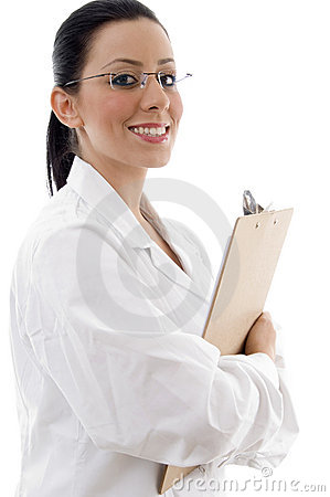 Side view of smiling doctor holding writing pad