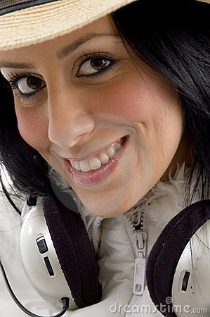 Side view of smiling female looking at camera