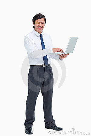 Side view of smiling tradesman with his laptop