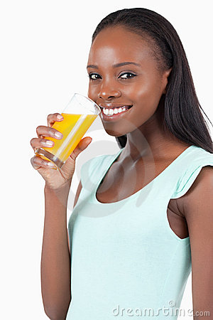 Side view of smiling woman with orange juice