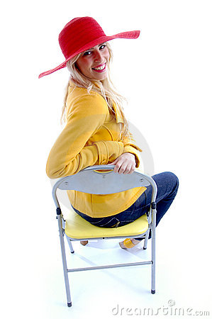 Side view of smiling woman sitting on chair