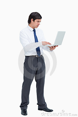 Side view of tradesman working on his laptop
