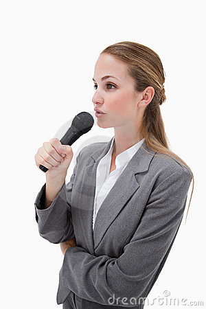 Side view of woman with microphone