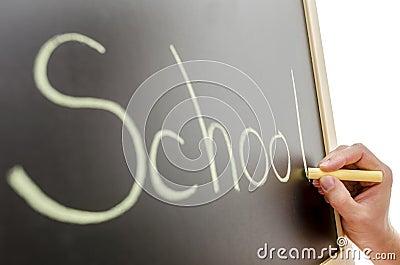 Side view of writing on blackboard