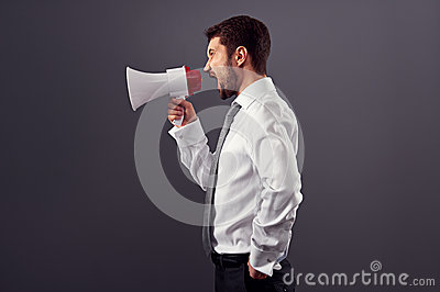 Sideview portrait of businessman with megaphone