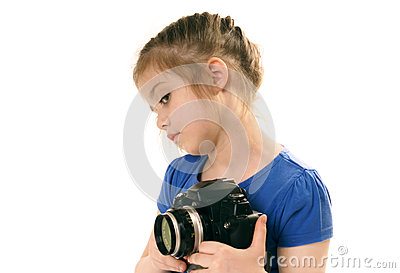 young girl with camera sideways glance