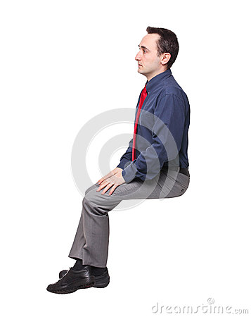 Siedzi mężczyzna
