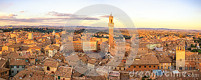 Siena sunset skyline. Mangia tower landmark. Italy