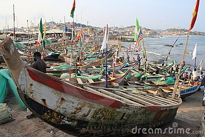 Siesta of fishermen in Cape Coast harbour, Africa Editorial Image
