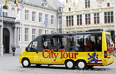 Sightseeing Bus in Brugge Editorial Photo