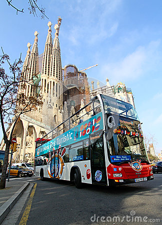 Sightseeing bus in front of Sagrada Familia Editorial Photo