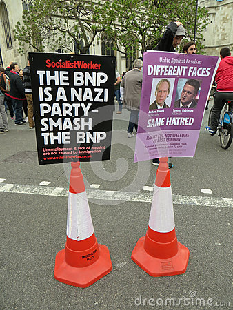 Sign against the BNP during a BNP protest in Londons Westminster Editorial Stock Image