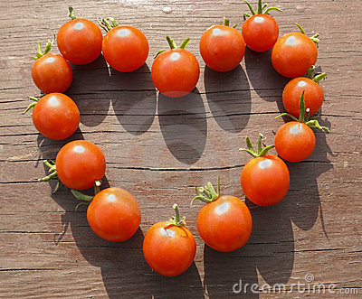 Sign of love. Heart made from small tomatoes