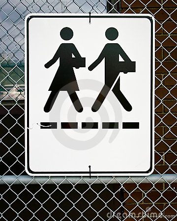 Sign - Man and Woman Walking with Briefcases