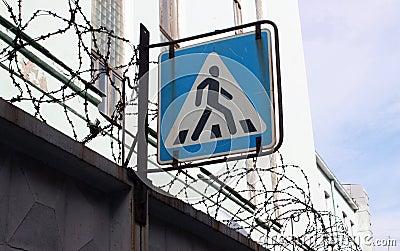 Sign of pedestrian crossing.