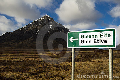 Sign pointing way to glen etive