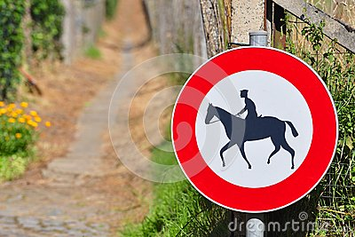 Sign prohibiting horseback riding