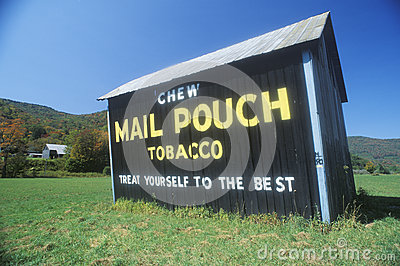 A sign that reads Chew Mail Pouch Tobacco Editorial Image